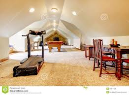 large long attic game room with tv pool and sport equipment