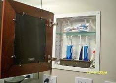 medicine cabinet with electrical outlet electrical outlet installed inside of medicine cabinet for the