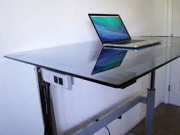rebel desk makes standing or sitting at work easy and optional