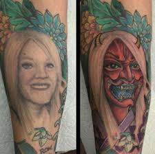 divorced man covers a tattoo of his ex wife u0027s face by turning her