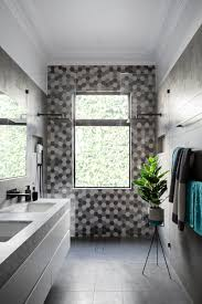 Modern Black And White Bathroom by Matte Black Accents Add Sophistication To This Grey And White