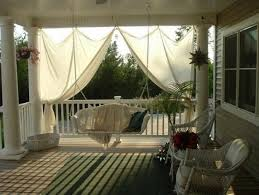drop cloth curtains for a porch add privacy and sun control within