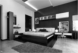 bedroom black headboard pretty wall lamp near nightstand pillow