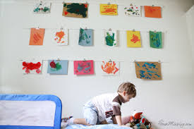 hanging kids artwork kid s art wall with clips house mix