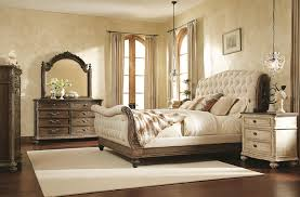 queen sleigh bed with linen tufted headboard and footboard by