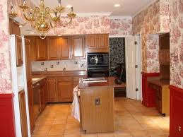 cottage style shaped kitchen with floral pattern wallpaper and