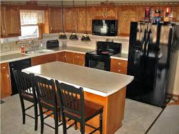 oak cabinets kitchens with black appliances and oak cabinets riothorseroyale