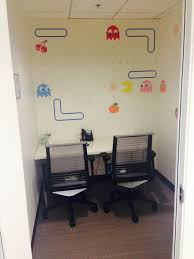 themed photo booth pacman themed phone booth roo okta office photo glassdoor