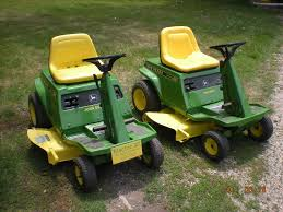 a nice pair of 1972 electric 90 battery powered lawn mowers john