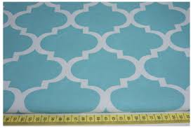 cotton 100 moroccan trellis on a turquoise background