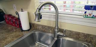 replacing a kitchen faucet replacing faucet completes kitchen remodel today s homeowner