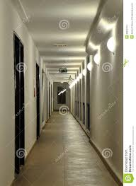the long corridor with a succession of wall lamps in its own