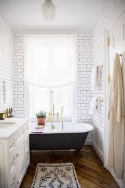 bathroom wall tile clawfoot bathtub brass finish tub faucet towl