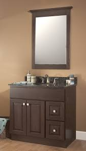 brown polished wooden narrow vanities with black top and sink plus