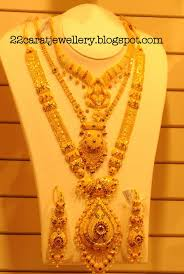 kalyan jewellers gold plain and antique bridal necklace sets