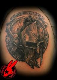 spartan with helmet and weapon tattoo on biceps photos pictures