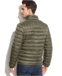 tommy hilfiger quilted packable down puffer in green for men lyst