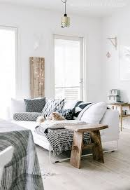 white sofa scandinavian interior living room fairy lights