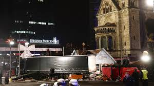 berlin attack police hunt tunisian suspect after finding id