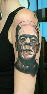 black and grey frankenstein head tattoo on left half sleeve