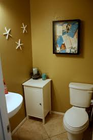 tiny half bathroom ideas 3 tiered light blue hanging toiletries