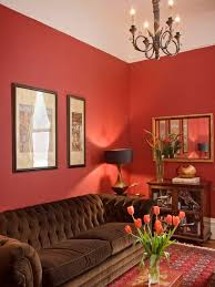 warm colorful room with red wall which blends nicely with the