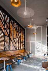 official designs light filled cafe and dark cocktail bar in dallas