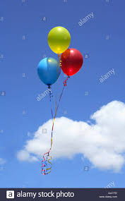 balloons that float three helium balloons floating in the sky stock photo 8351052 alamy