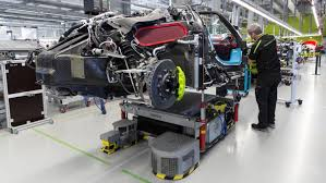 porsche 918 spyder engine number 918 rolls out of the manufactory