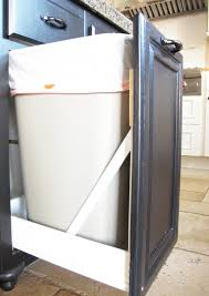 trash can attached to cabinet door turn a drawer and a door into a pull out trash ca diy