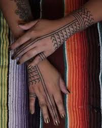 filipino tribal snake scales and tongue design hand tapped by the