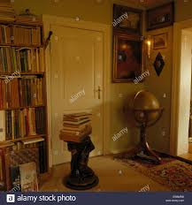 swedish country antique globe in library in swedish country house stock photo