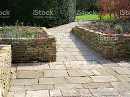Raised Patio Pavers by Image Of Raised Garden Beds With Flagstone Paving Patio