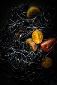 squid ink pasta with garlic and tomatoes squid ink pasta food