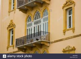 ornamental windows and parapets of a balcony on an classical