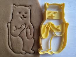 cookie cutter cat with middle finger sceptical cookiecutter