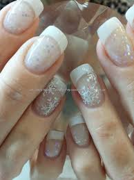 white acrylic tips with glitter acrylic and freehand snowflake