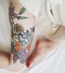 insanely beautiful nature tattoos on thigh for girls styles time