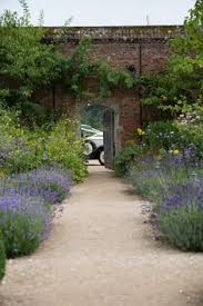 the walled garden cowdray alcove decorated with glass stem vases