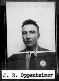 j robert oppenheimer working out physics equations on the