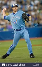 roy halladay among the sports toronto blue jays starting pitcher roy halladay 32 throws a