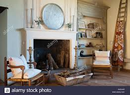 Wooden Armchairs Wooden Armchairs And Log Basket By Large Open Fireplace In