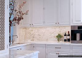 marble subway tile backsplash with white kitchen cabinet and