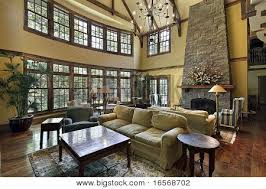 Large Family Room With Two Story Stone Fireplace Image Cgpc - Two story family room
