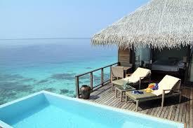 chambre sur pilotis hôtel coco bodu hithi 5 maldives réservation photos descriptif