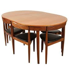 beauty round to solid walnut jupe dining table with hidden chairs