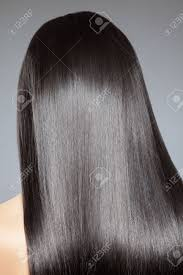 back view of a woman with long straight hair stock photo picture