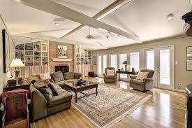 Cathedral Ceilings In Living Room Cathedral Ceiling Living Room With Wooden Floor And Crossed Beams
