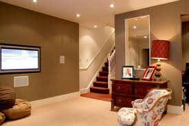 simple basement with dark green wall paint filled with splendid
