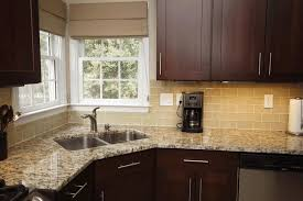 dark brown wooden kitchen counter yellow brick wall tile smooth